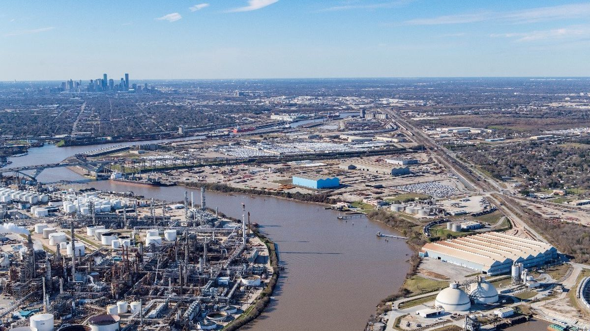 Aerial view of Houston Ship Channel with Houston skyline in background